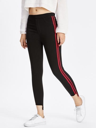 Pantalons avec pan découpé rayure bicolore