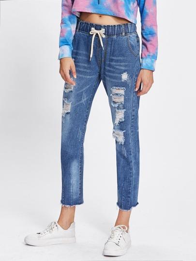 Jeans avec cordon avec pan déchiré