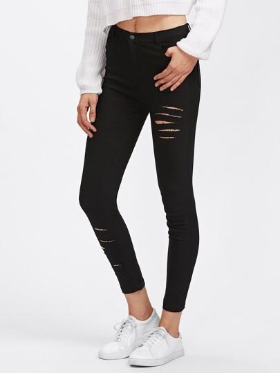 Pantalones con rotura