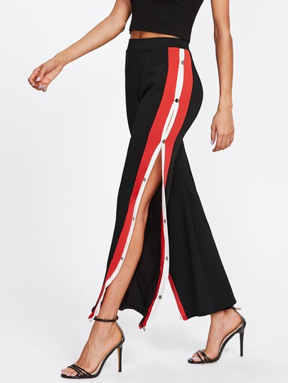 Pantaloni con bottoni laterali