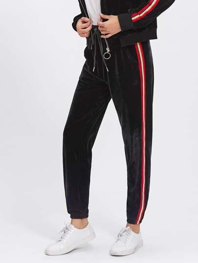 Pantalones de terciopelo a rayas laterales