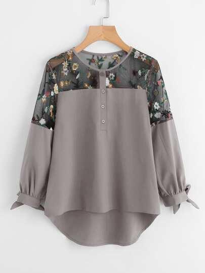 Blusa asimétrica con bordado de malla con lazo para atar
