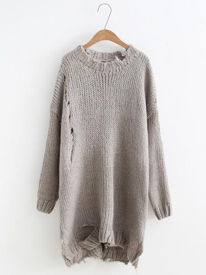 Suéter largo roto con abertura lateral