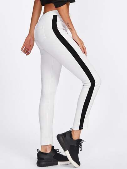 Pantaloni a strisce laterale