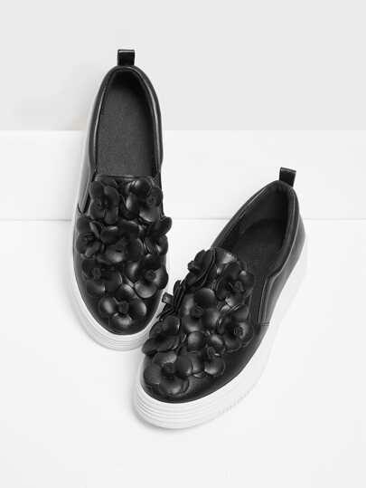 Zapatillas embellecidas de flor