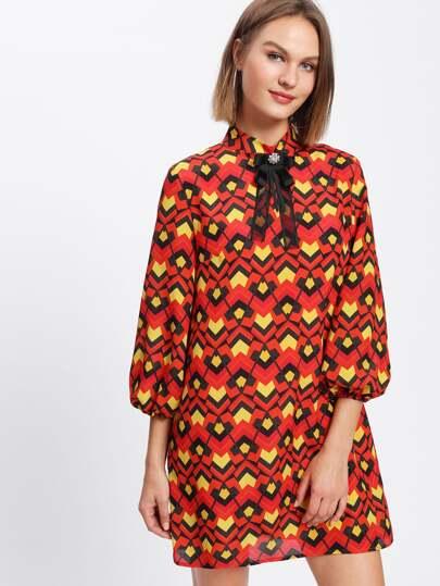 Vestido de manga farol con adorno de lazo y pedrería