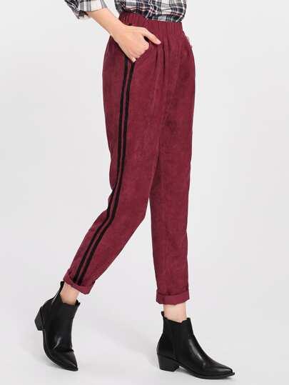 Pantalones de rayas laterales