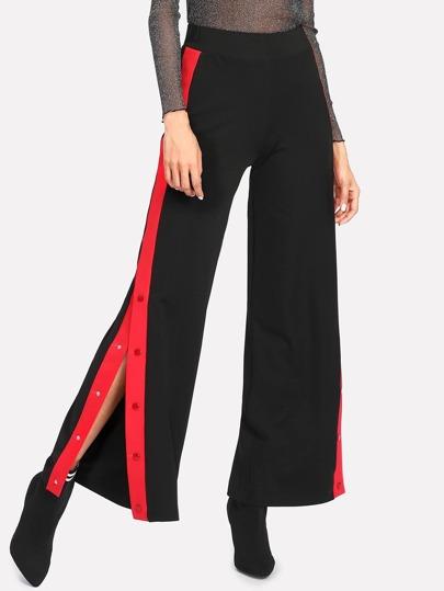 Pantalons fendu avec bande contrastée