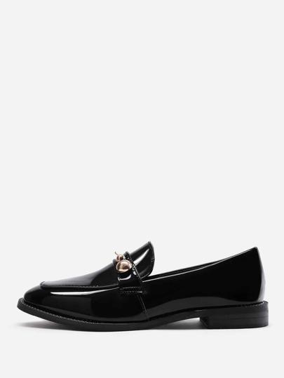 Chaussures plates avec détail de métal