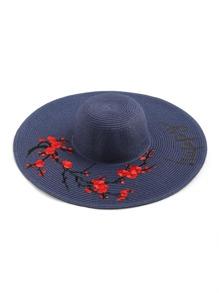 Cappello in paglia con ricamo di fiore