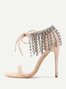 Sandalias de tacón alto con flecos y cordones