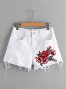 Shorts en jeans avec pan déchiré avec applique brodé