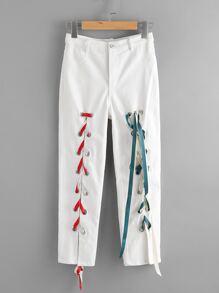 Pantaloni skinny con laccetti sul davanti