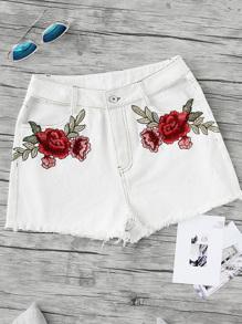 Pantaloncini con applique di rosa ricamata