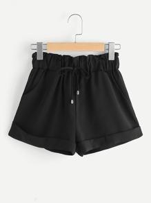 Shorts avec des replis et une ceinture