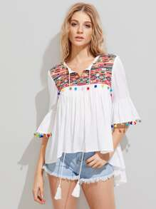 Embroidered Yoke Pom Pom Trim Staggered Hem Blouse