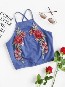 Top croisé à carreaux avec le zip et des pièces des fleurs