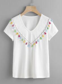 Tee-shirt découpé versicolore avec des franges