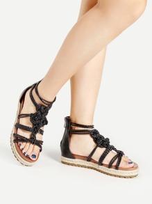 Sandales à fond plat à bretelle tissée