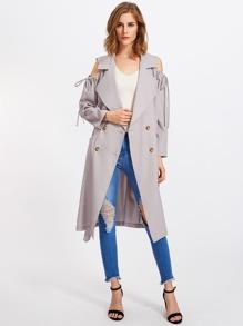 Manteau épaules dénudées avec un lacet