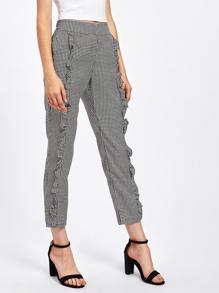 Pantalons découpé à carreaux avec des plis