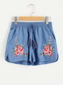 Tasseled Tie Flower Embroidered Dolphin Shorts