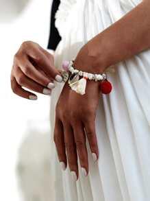 Set di braccialetto con pompon e nappa