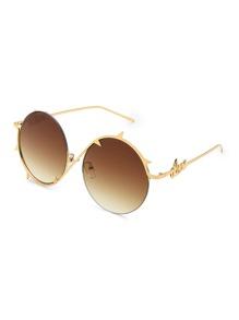 Gafas de sol redondas con montura asimétrica y lentes de ombré