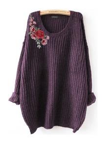 Maglione con toppa ricamata di fiore