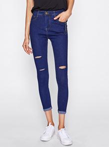 Jeans moulant avec trou au genou