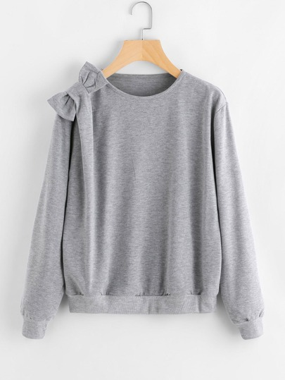 Sweat-shirt en tricot avec nœud papillon