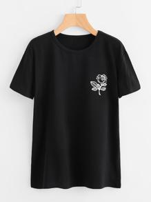 T-shirt con stampa di rosa