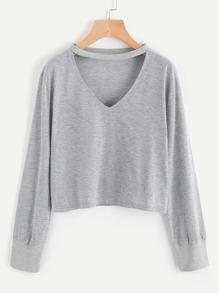 Camiseta de lana escote V