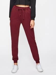 Pantalones con cordón ajustable