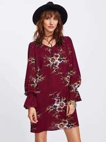 Vestido túnica con puños elásticos y estampado botánico