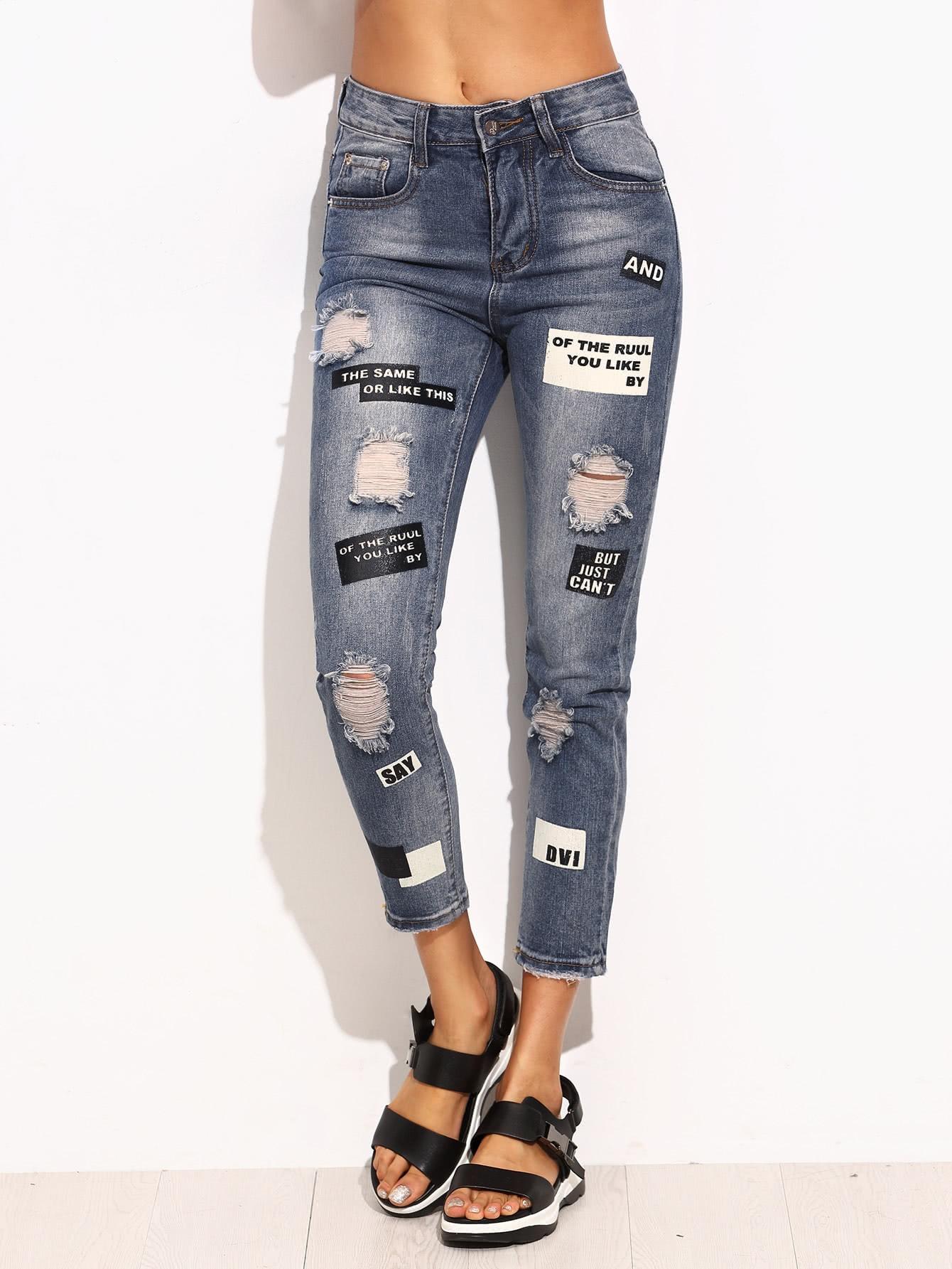 Синие рваные облегающие джинсы с текстовым принтом