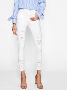 Raw-Cut Distressed Skinny Jeans