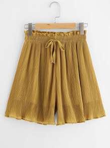 Shorts taille ruchée avec des plis