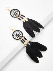 Boucles d\'oreille design de dreamcatcher avec plume