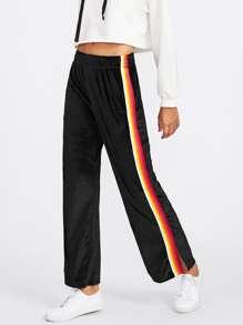 Pantalones a rayas de terciopelo