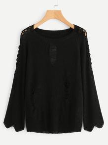 Sweater lacéré manche croisée