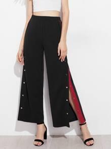 Pantalons bicolore avec bouton divisé côté