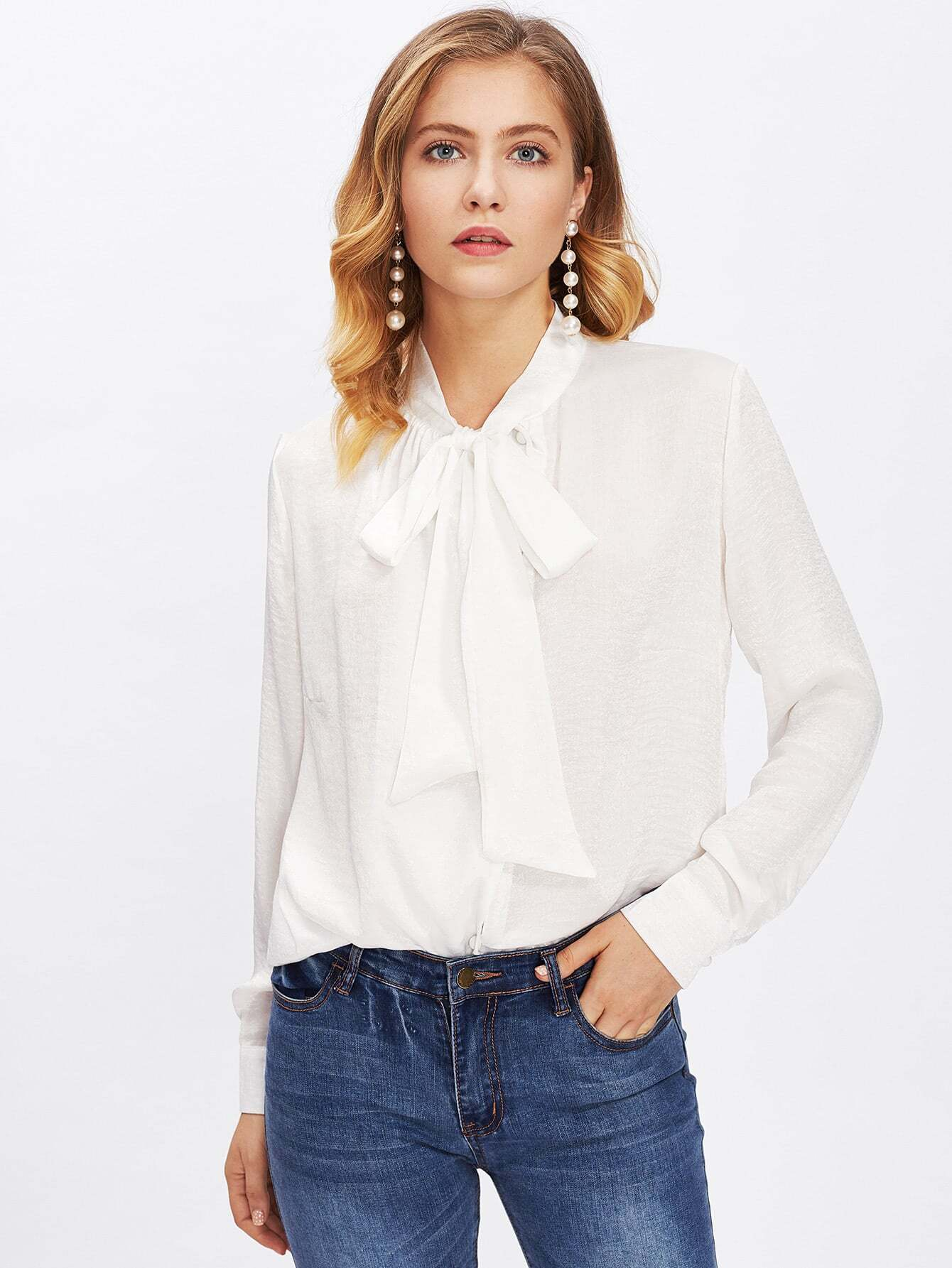 Easy blouse with a tie-front design, soft and lightweight fabric and button-front accent. Imported/5(62).