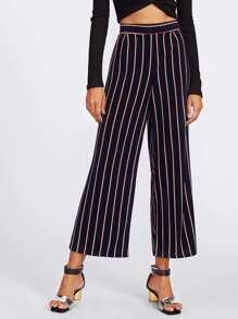 Pantalones a rayas con pernera ancha