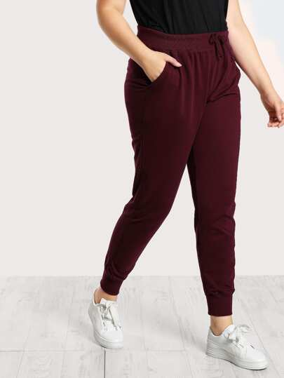 Pocket Side Solid Peg Sweatpants