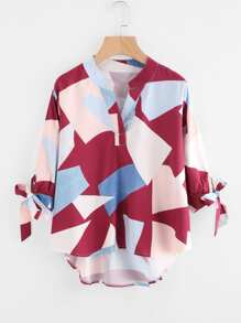 Abstract Geo Print Tie Cuff Dip Hem Blouse