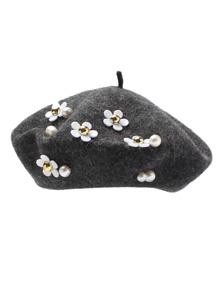 Gorra con flor y perla