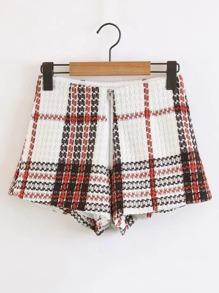 Shorts en tweed à carreaux avec le zip