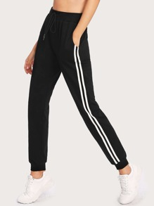 Pantalones de rayas laterales con cinturón