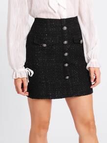 Jupe en tweed avec une rangée des boutons